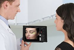 Specialist showing screen analysis to patient